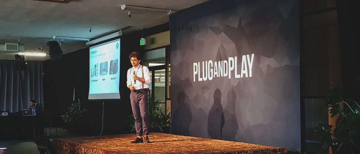 Dwight Leone, founder of CargUp, on stage at Plug & Play